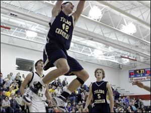 Toledo Christian's Ethan Michael takes flight during Friday night's action in the Knight Christmas Classic.