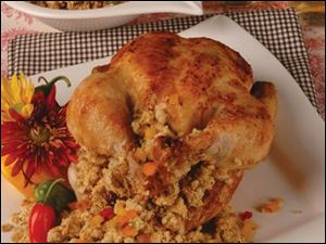 Easy yet elegant recipes, like this stuffed chicken with rice side dish, are sure to impress your holiday guests.