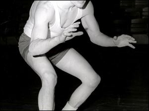 Although only 5 feet, 5 inches tall, Dick Wilson was a fierce competitor, and he used the passion that made him a champion wrestler to nurture, coach, and mentor athletes.