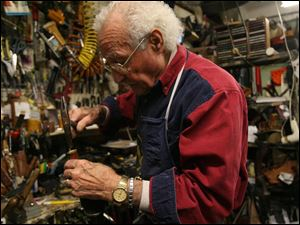 Pasquale DiTerlizzi, who has been in the shoe-repair business 62 years, said his shop has become busier than ever, with customers bringing in handbags, suitcases, backpacks, and gloves as well as shoes.