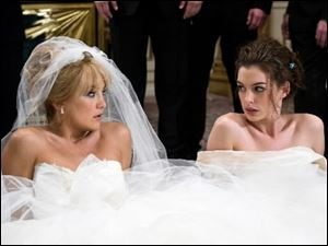 Kate Hudson, left, and Anne Hathaway in 'Bride Wars.'