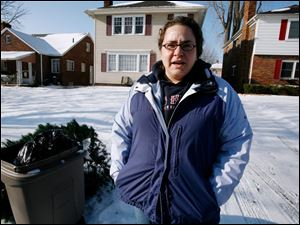 Melissa Miller is among 20 percent of Toledoans who had difficulty with the city's new trash pickup arrangement. She says she was about to place her trash out at the curb on the normal pickup day before being reminded of the schedule change. Pickup dates will rotate according to holidays to avoid paying overtime.