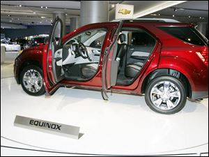 The 2010 Chevrolet Equinox was designed with a vertical pillar in the liftgate to help reduce wind resistance and therefore increase fuel efficiency.