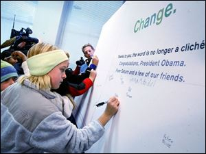 Maddie Freeman of Ottawa Hills Elementary adds her name to the message of change going to next week's inauguration.