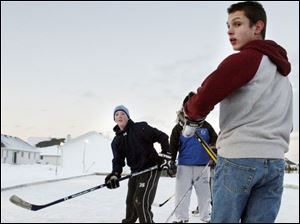 Mauder Louis Szilagyi, l6, right, watches as Mitchell Mauder, 14, sends a puck zooming past him during a pickup game.