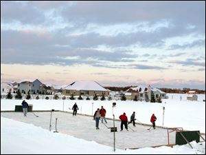 On any given cold winter day, the backyard rink at the Mauder household in Lake Township is dotted with hockey players.