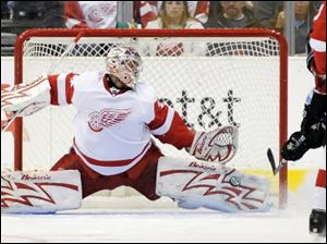 Red Wings goalie Ty Conklin stops a shot by Kings right winger Dustin Brown.