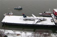 Fuel-drained-from-US-Airways-jetliner-to-prepare-for-move-across-Hudson