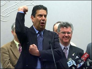 Jon  Bowzer  Bauman demonstrates his trademark move as Bowzer when he was in the band Sha Na Na at a 2006 news conference in Connecticut about his Truth in Music bill.