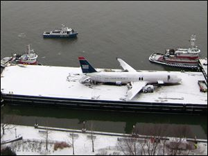 The ruins of what was US Airways Flight 1549 lays on a barge in the Hudson River. The plane will be moved to a New Jersey site, where it can be examined further.