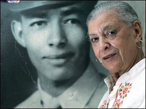 Gladys V. Glenn will attend the inauguration in place of her late husband, Glenn, whose photo she stands in front of.
