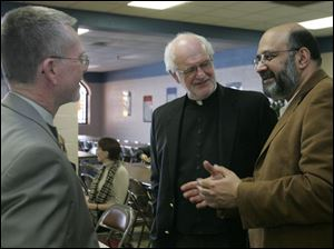 The Rev. Larry Clark, left, the Rev. Martin Donnelly, and Dr. S. Zaheer Hasan speak at the Islamic Center of Greater Toledo.