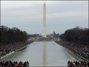 Crowds pack the mall in front of the Washington Monument as they await the start of the inaugural kickoff concert.