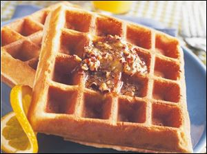 Serve Golden Waffles with pecans and maple syrup.