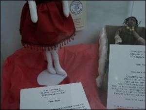 Personal stories accompany some of the dolls on display.