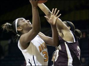 Tanika Mays works inside against Central Michigan's Latisha Luckett. Mays scored 15 for the Rockets, now 4-1 in the MAC.
