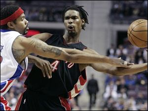 The Pistons  Rasheed Wallace fouls Chris Bosh, who led the Raptors with 19 points.
