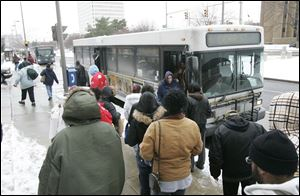 Passengers at the Seagate Station downtown change buses on the TARTA system, which experienced an increase in riders last year.