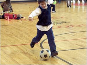 Winfield Vincent, 6, tries his foot at soccer to count to the number 100.