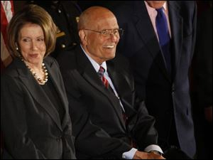 Rep. John Dingell, flanked by House Speaker Nancy Pelosi and former President Bill Clinton, basks in the attention at a reception. He is a longtime backer of the auto industry.