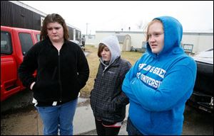 Morgan Carpenter, 16, MaKayla Ackerman, 13, and Breanna Perry, 16, discuss Jacob Polen and David Todd, who were killed in a single-car crash on Tuesday night. The two were passengers in a car driven by Glenn Walbolt, 56, who survived.
