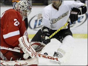 Red Wings goalie Ty Conklin stops the Ducks' Teemu Selanne's shot in the second period last night in Detroit.