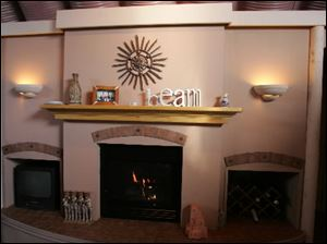 The room's Southwest theme is carried through in the mantel decorations.