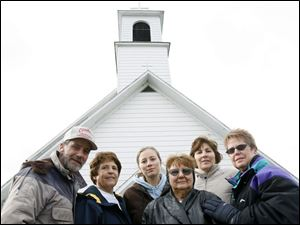 Former parishioners of the closed St. James Catholic Church in Kansas, Ohio, are taking their fight to the Ohio Supreme Court. From left are Ed Row, Virginia Hull, Sarah Kleinfelter, Helen Durst, Margie Steinmetz, and Sue Schwab, shown in 2007.