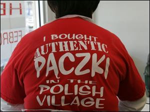 Annie Walker helps with the Polish Village paczki sale, which ends Tuesday.