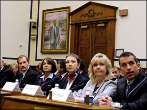 From left, Capt. Chesley Sullenberger III, 1st Officer Jeffrey Skiles, flight attendants Sheila Dail, Donna Dent, and Doreen Welsh, and air traffic controller Patrick Harten testify before the subcommittee of the House Transportation and Infrastructure Committee. They spoke on the safe landing the US Airways Flight 1549.