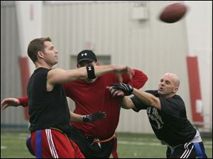 Dan Nowak, left, gets a pass off during a game at Sylvania Sport and Exhibition Center.