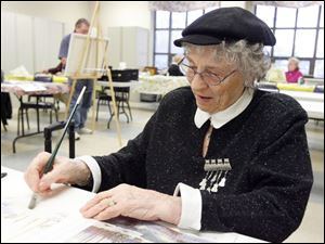Norma Veit works on a watercolor at the Sylvania Senior Center.