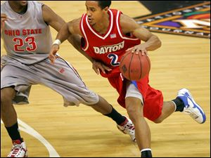 Dayton's Brian Roberts drives past Ohio State's David Lighty last year. Roberts, a St. John's Jesuit graduate, is UD's all-time 3-point shooter.