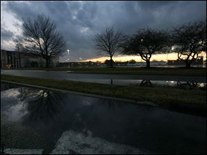An ominous sky looms over the West Toledo area Sunday evening.