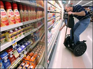 Dr. McNamara does his grocery shopping on the two-wheeled device.