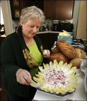Paula Ross makes a plate of endive with dip for her dinner party for author Marion Nestle and other guests.