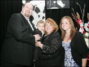 Ken Kemerer, left, son, Gary, wife, Mary, and her daughter Caitlin Bolick star at the Toledo Children s Hospital event. Gary was premature and weighed just 1 pound, 15 ounces at birth and spent the first three months of his life in the hospital.  