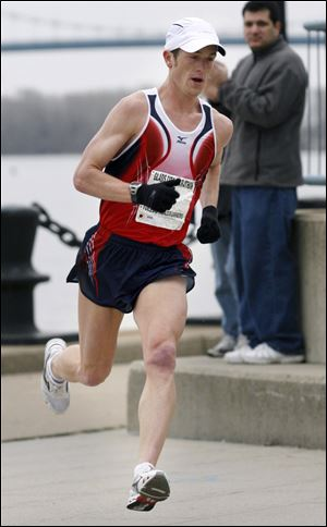 Ryan Desgrange heads to the finish line to win the Glass City Marathon in 2006. He's now 29.