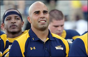 Ex-UT star Bruce Gradkowski returned as a guest coach.