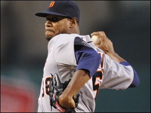The Tigers' Edwin Jackson works against the Los Angels in the