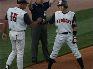 The Mud Hens  Jason Tyner is congratulated by manager Larry Parrish after smacking a triple