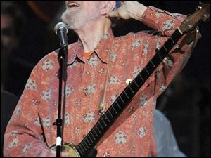 Pete Seeger performs at the benefit concert celebrating his 90th birthday at Madison Square Garden on Sunday. The concert is a benefit for Hudson River Sloop Clearwater, created by Seeger to preserve and protect the Hudson River.