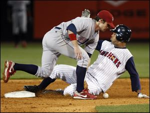 The Mud Hens' Wilkin Ramirez steals second base in the fourth inning when Jason Donald can't come up with the throw.