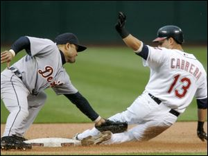 The Tigers' Placido Polanco slaps the tag on the Indians' Asdrubal Cabrera, who was trying to stretch a single into a double.