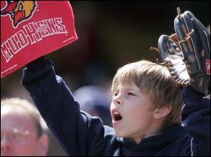 Joel Gyurasics, a third-grader at Toledo Christian, is ready to catch the ball at the Fifth Third Field on Monday.