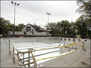 One of the two new swimming pools at Stone Oak Country Club is part of $2 million in improvements made at the Springfield Township facility to help stem diminishing membership.