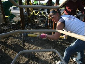 Cori Whipple helps works on the playground at the school off the Anthony Wayne Trail.
