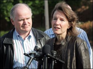 Susan LeFevre, with her husband, Alan Walsh, speaks with reporters after her release from the Huron Valley prison.