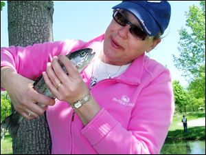 Patti Schebil of LaSalle, Mich., takes a good look at her