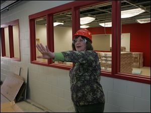 Library media specialist Patti Rish looks around what will be the media center.